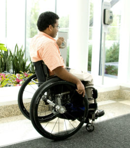 Seated in his wheelchair and was in the process of exiting build